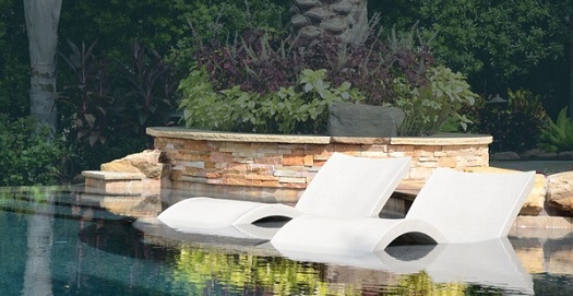 Above A Pair Of Red Ledge Loungers Really Make Their Mark In This Freeform Pool With Large Tanning