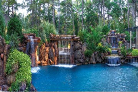 A Large Cascading Rock Waterfall Or Three Provides The Perfect Backdrop For Lagoon Style Pool Adding Both Visual And Acoustic Ambiance