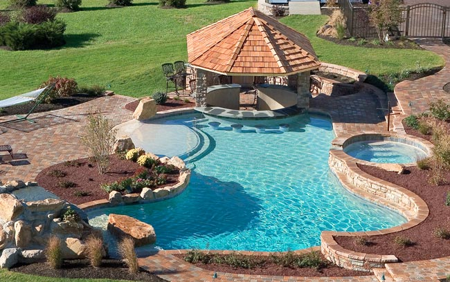 Types Of Natural Stone And Wood Decking As Well Concrete Tile Aggregate Options For Your Pool